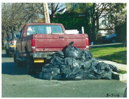 Garbage bags of construction debris that were picked up on Fennimore Avenue in March 2016 by two Yonkers DPW workers for cash