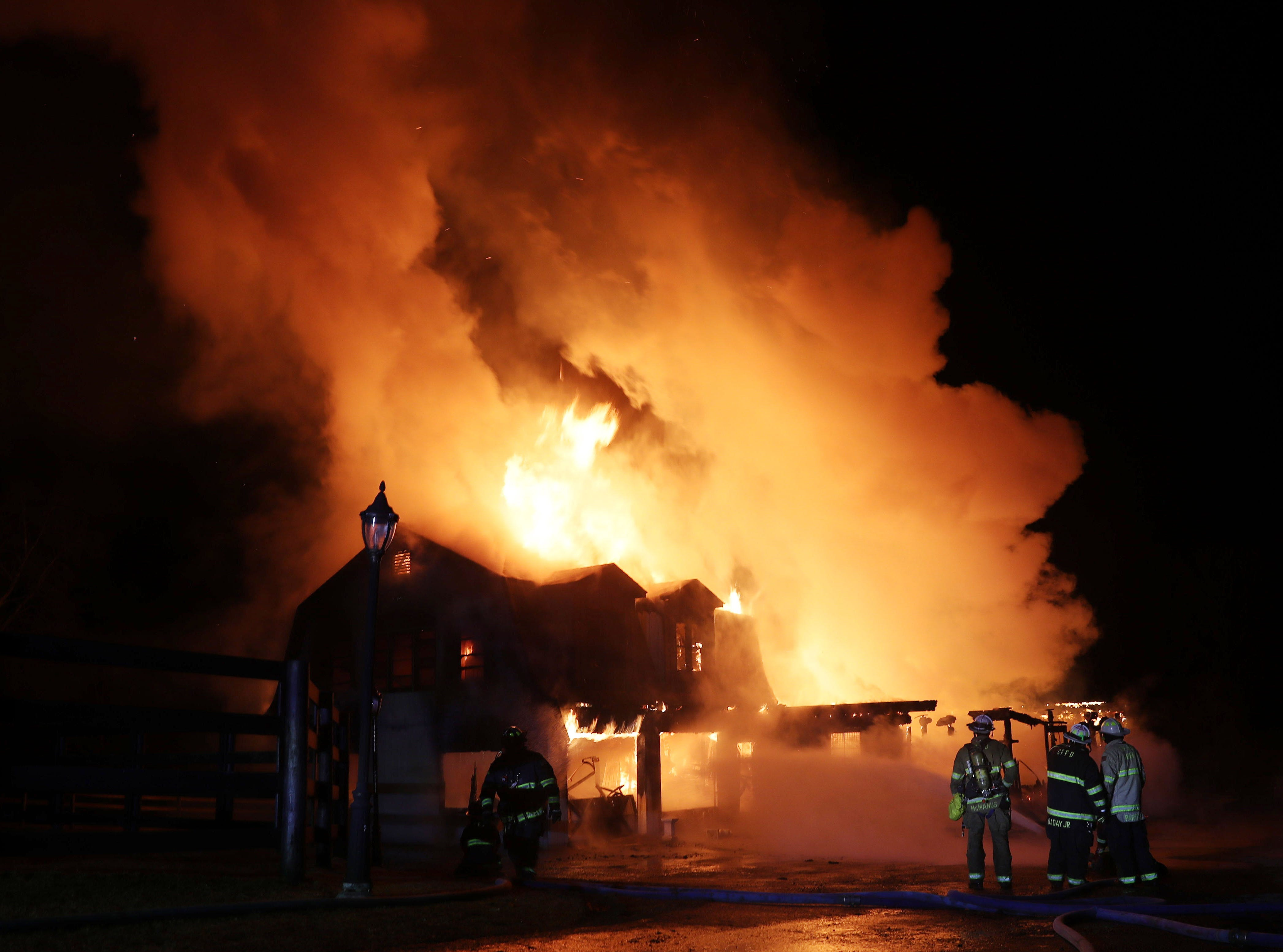 Croton Falls firefighters battle an early morning fire that destroyed a large barn on Croton Falls Road in the town of Carmel Feb. 7,  2019.