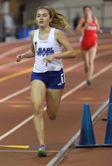 Pearl River's Mary Borkoski wins the Girls 3200 Meter Run during the Section 1 Class B track & field Championships at the Armory in Manhattan Feb. 6, 2019.