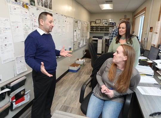 Joe Fitzpatrick, president of Lightning Express Inc. Delivery and Air Freight Service in Modena, New York, chats with employees Lexi Mallory and Michelle Critelli at the warehouse and distribution center, Feb. 7, 2019.
