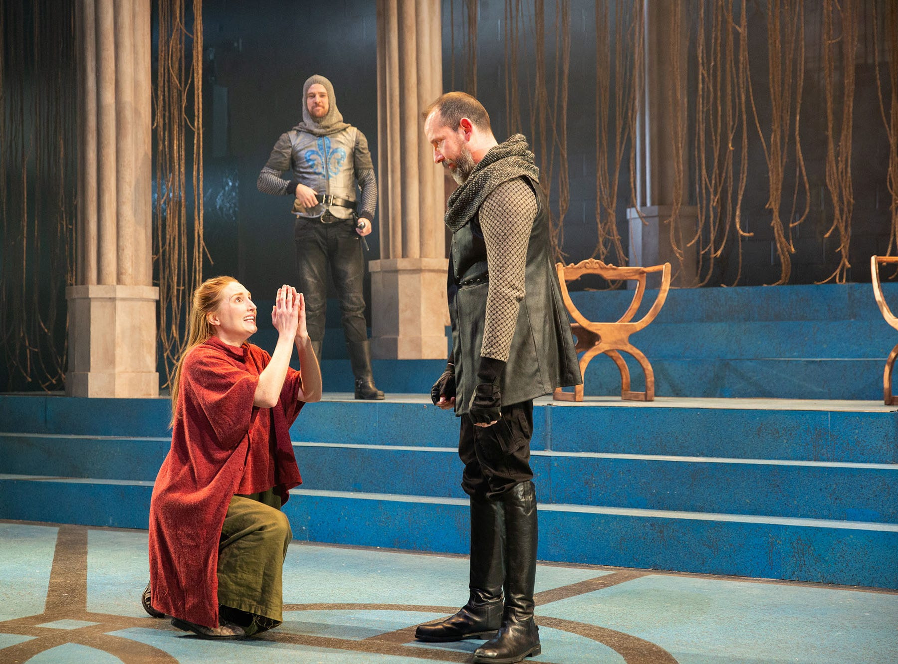 "Clare O'Malley, left, plays Joan of Arc in  ""St. Joan"" at Delaware Theatre Company with Sean Michael Bradley, center, and Charlie DelMarcelle."