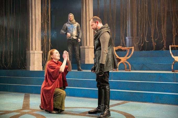 """Clare O'Malley, left, plays Joan of Arc in  """"St. Joan"""" at Delaware Theatre Company with Sean Michael Bradley, center, and Charlie DelMarcelle."""