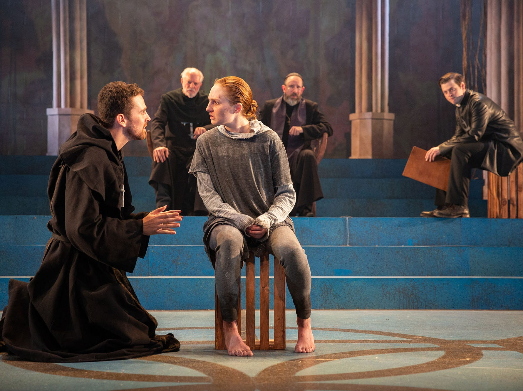 "Clare O'Malley, center, stars at ""St. Joan"" at Delaware Theatre Company with, from left, Sean Michael Bradley, Dan Kern, Charlie DelMarcelle and Michael Doherty."