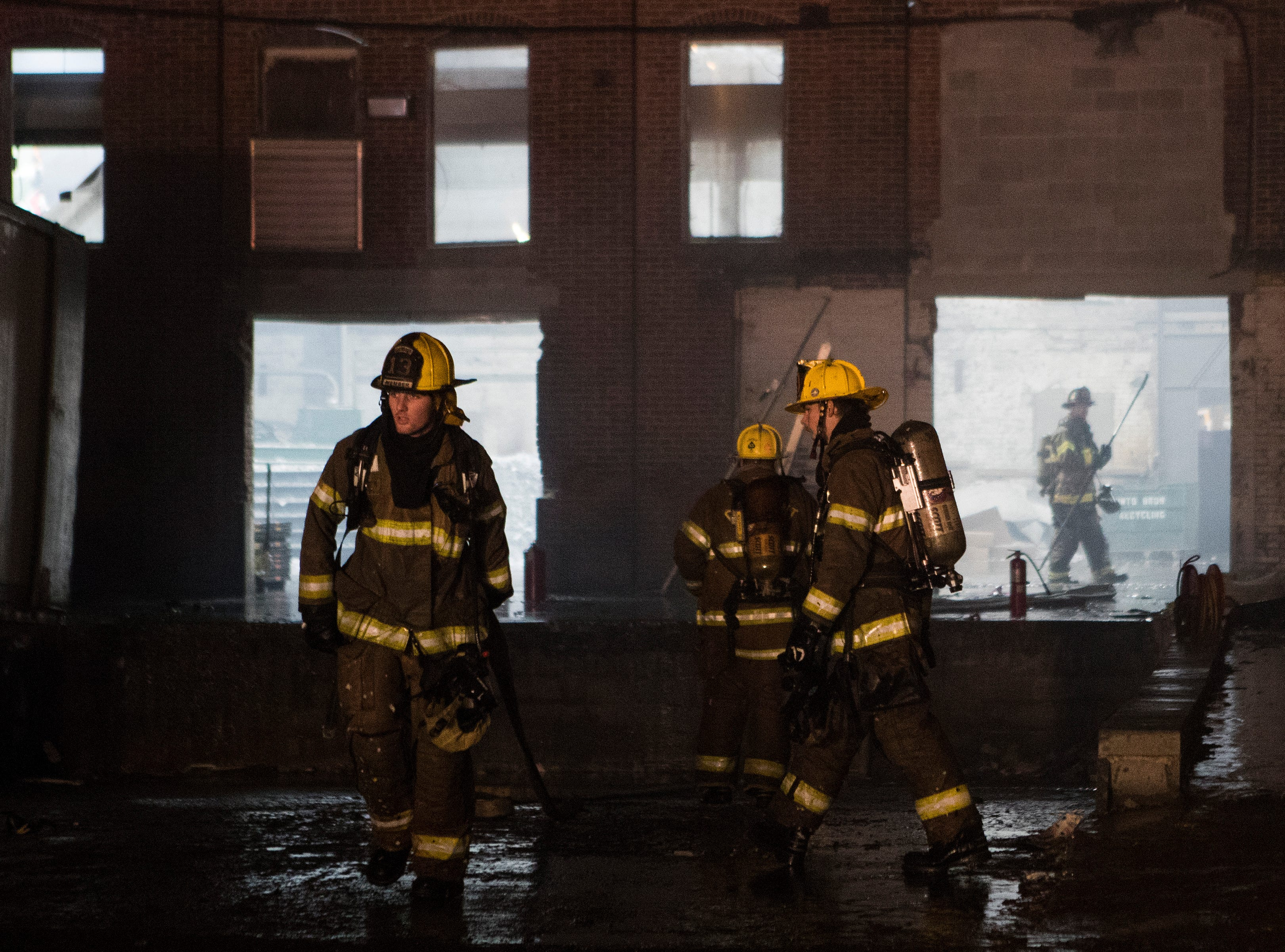 Multiple fire companies work the scene of a paper fire at Recycling Management Resources Wednesday night in Fox Point.