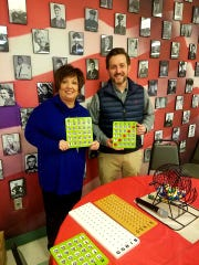 First National Bank donated new bingo cards and other bingo items to The Red Door Senior Center.  The previously used bingo items were worn and the numbers were fading.  The Kitchen and the seniors who enjoy the weekly bingo games appreciates this generous gift.   Pictured: Jackie Hamm, CEO for The Kitchen and Gordon McCain from First National Bank.