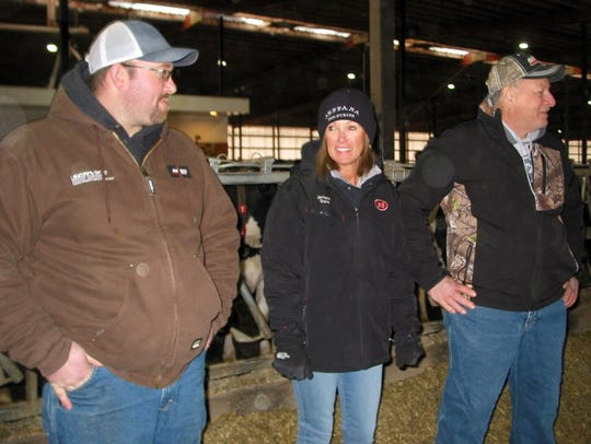 "Chris ""Bucky"" Henschel (left), his mother, Diana, and dad, Jeff, provide most of the labor for their dairy operation."