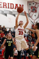 Sheridan's Emma Conrad puts up a shot against Tri-Valley Wednesday night.