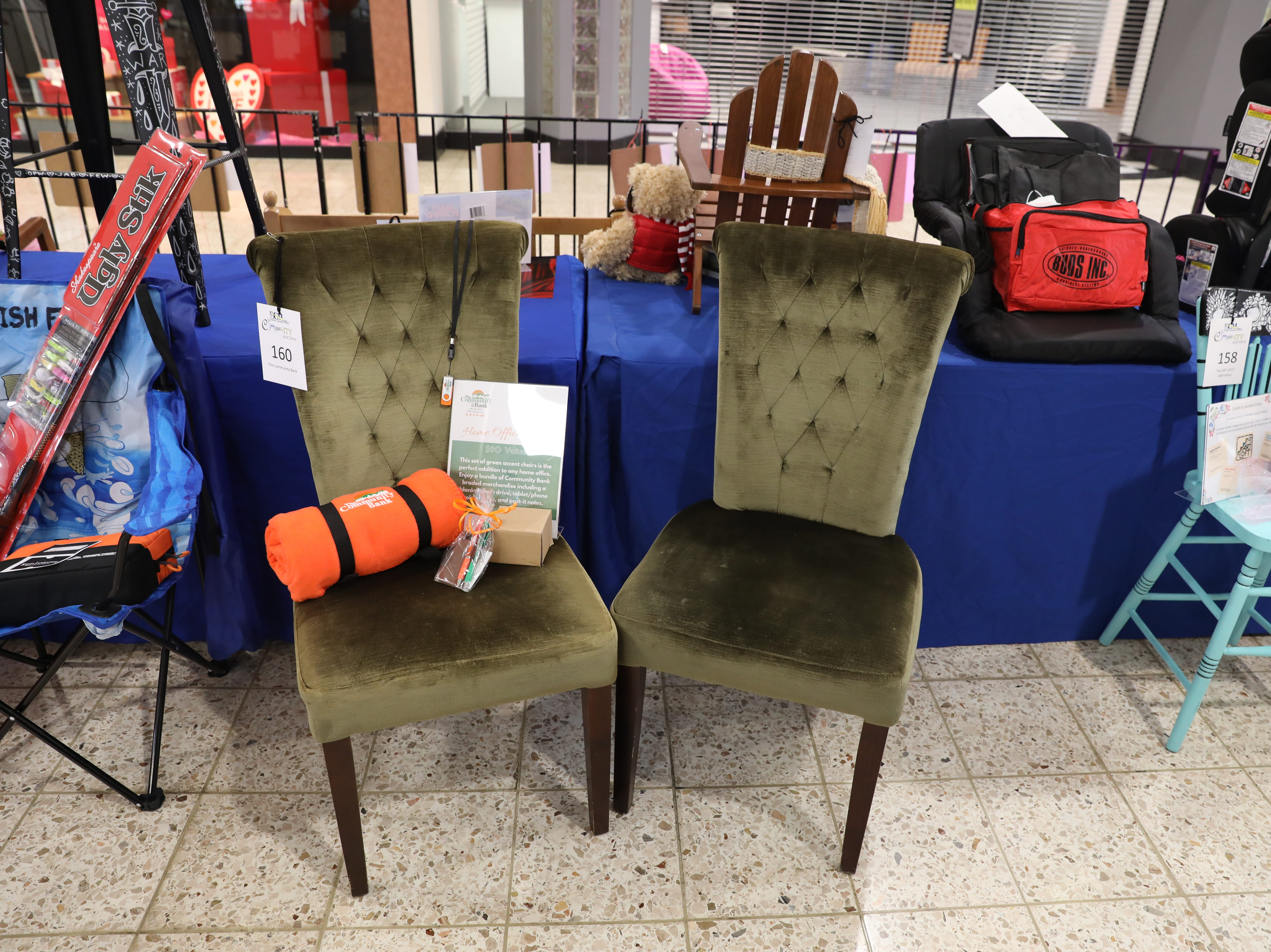 Chairs in the silent auction for Eastside Community Ministries' CHAIR-ity auction. Each chair comes with an incentive. Bids will be accepted until 6 p.m. Saturday. The auction is at the Colony Square Mall.