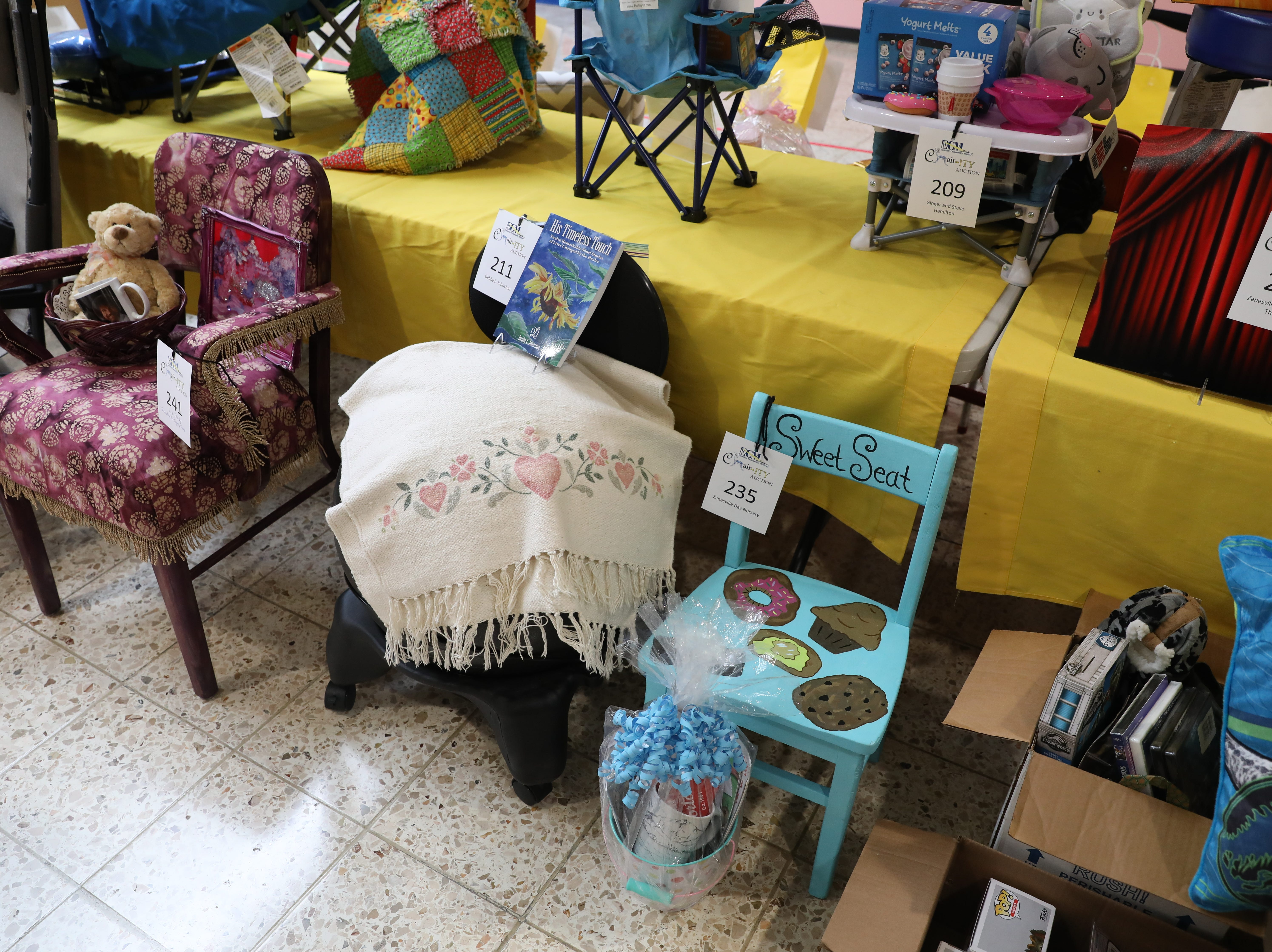 Chairs in the sealed-bid auction for Eastside Community Ministries' CHAIR-ity auction. Each chair comes with an incentive. Bids will be accepted until 6 p.m. Saturday. The auction is at the Colony Square Mall.