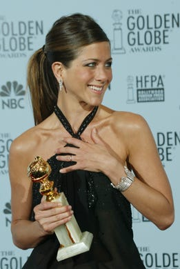 Jennifer Aniston looks better than ever at 50 as she poses