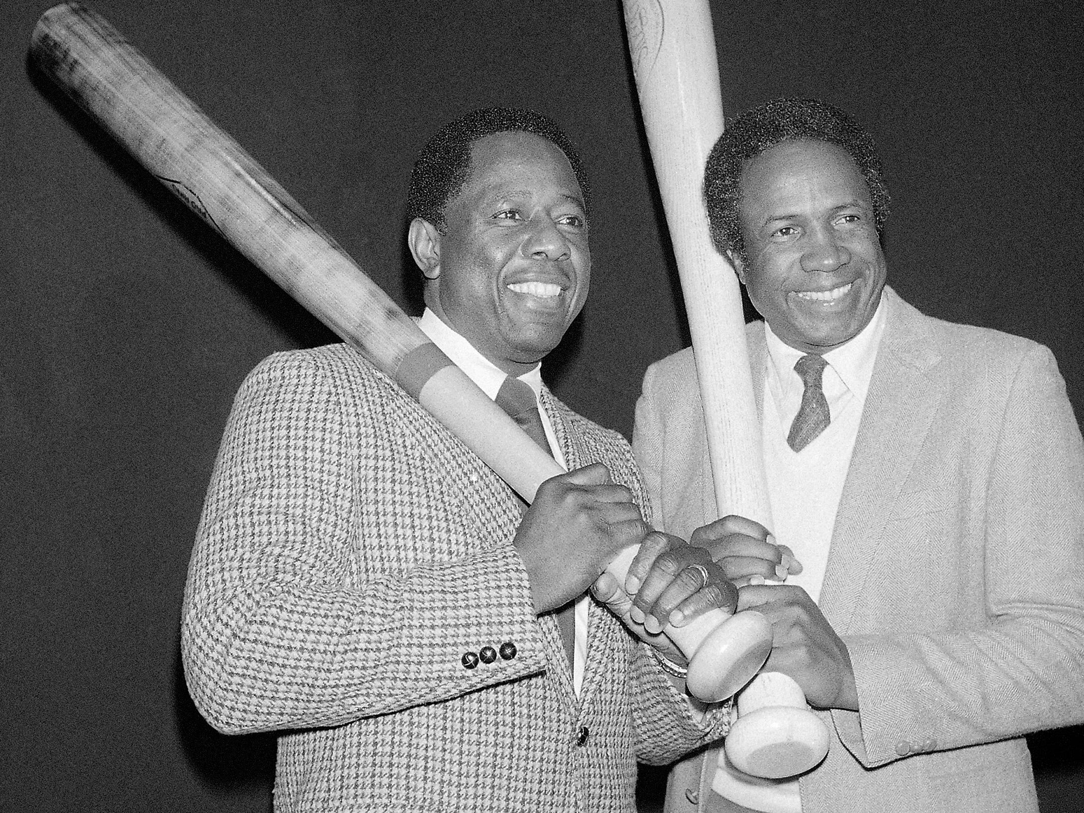 Hank Aaron, left, and Frank Robinson pose together after being voted into baseball's Hall of Fame in 1982.