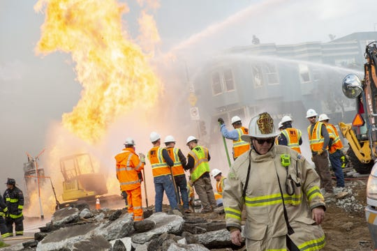 Fire Chief Joanne Hayes-White is on the scene as PG&E representatives and firefighters battle a blaze following an explosion of a gas line on Wednesday in San Francisco.