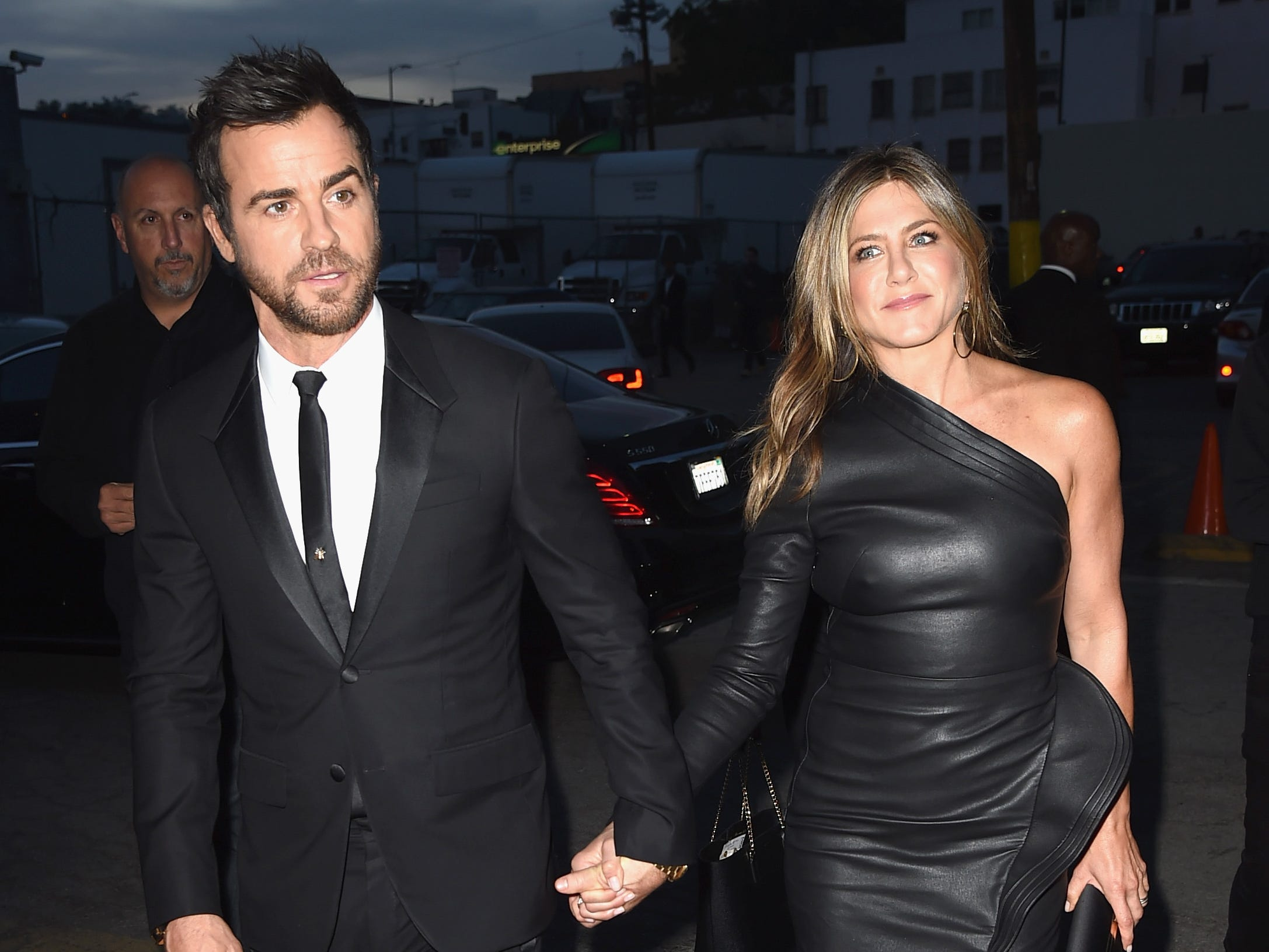 """Aniston, who often dressed edgier during her relationship with Theroux, sported an asymmetrical leather minidress at the final-season premiere of his HBO drama """"The Leftovers"""" in April 2017."""