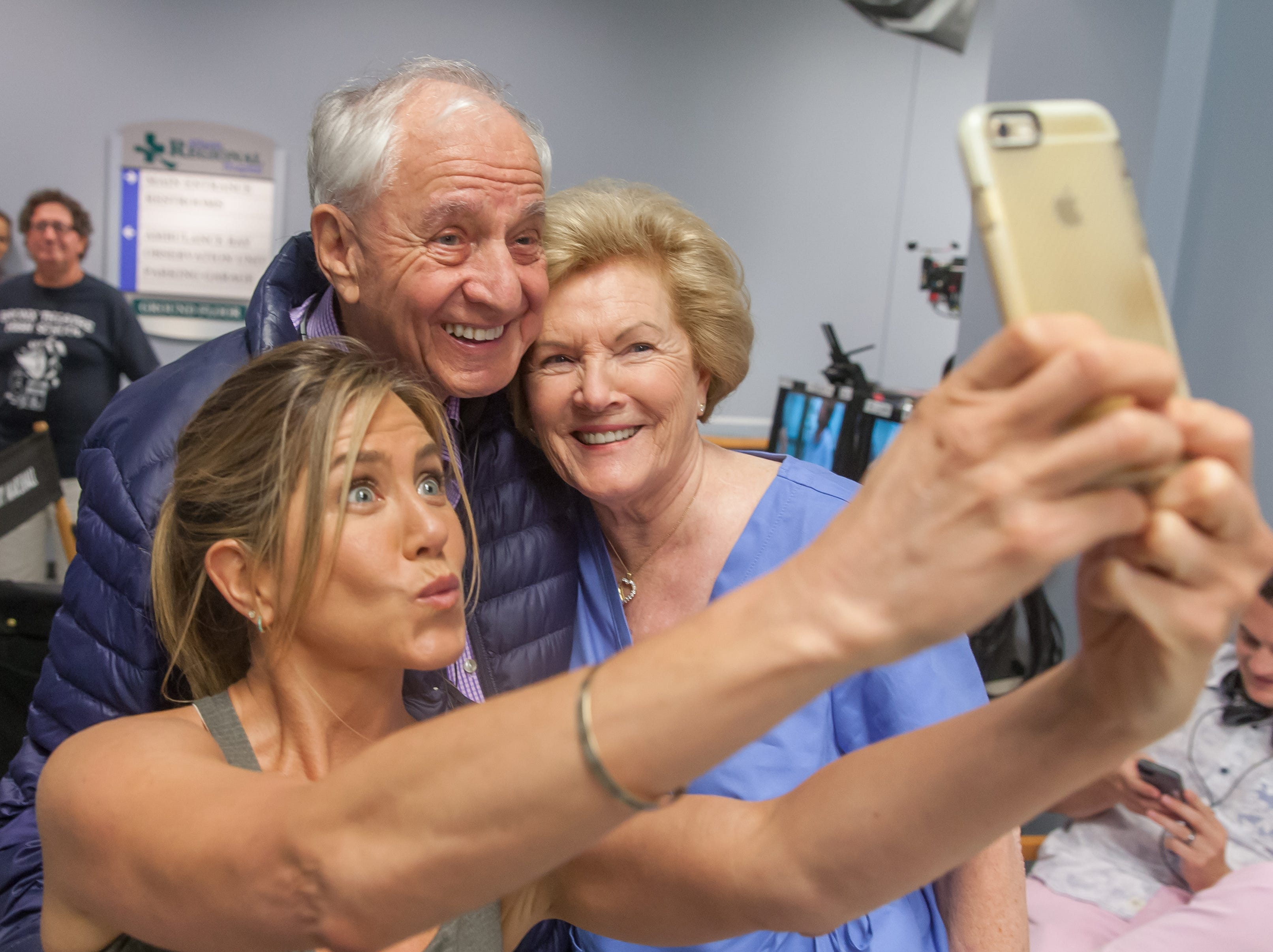 """While shooting her 2016 rom-com """"Mother's Day,"""" Aniston took the opportunity to shoot a selfie with director Garry Marshall and his wife Barbara."""