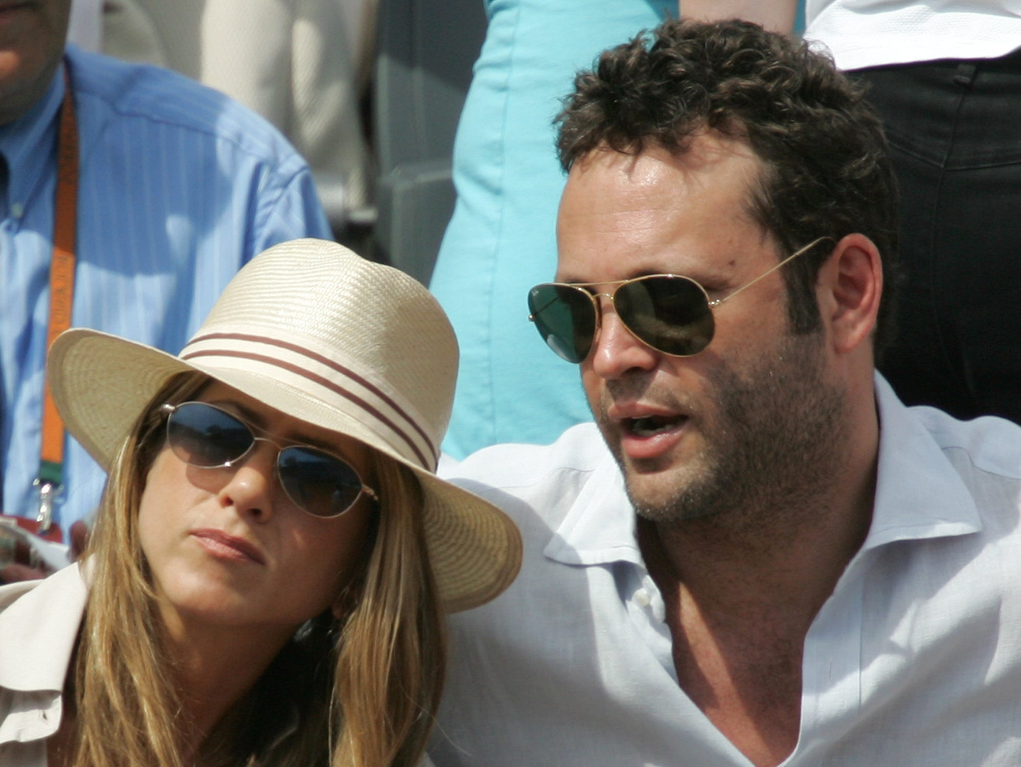 """Aniston's next public romance was with Vince Vaughn, her co-star from the 2006 comedy """"The Breakup."""" The couple, seen here at that year's French Open tennis tournament in June, split later that year."""