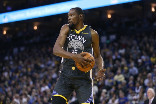 e2a777a45824 Golden State Warriors forward Kevin Durant grabs a rebound against the San  Antonio Spurs.