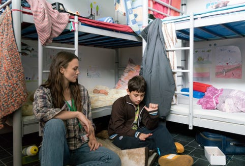 """A social worker (Keira Knightley) helps a young refugee (Liam Gross) in """"Berlin, I Love You."""""""