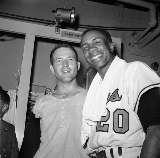 Frank Robinson and Orioles pitcher Dave McNally in a 1966 photo.