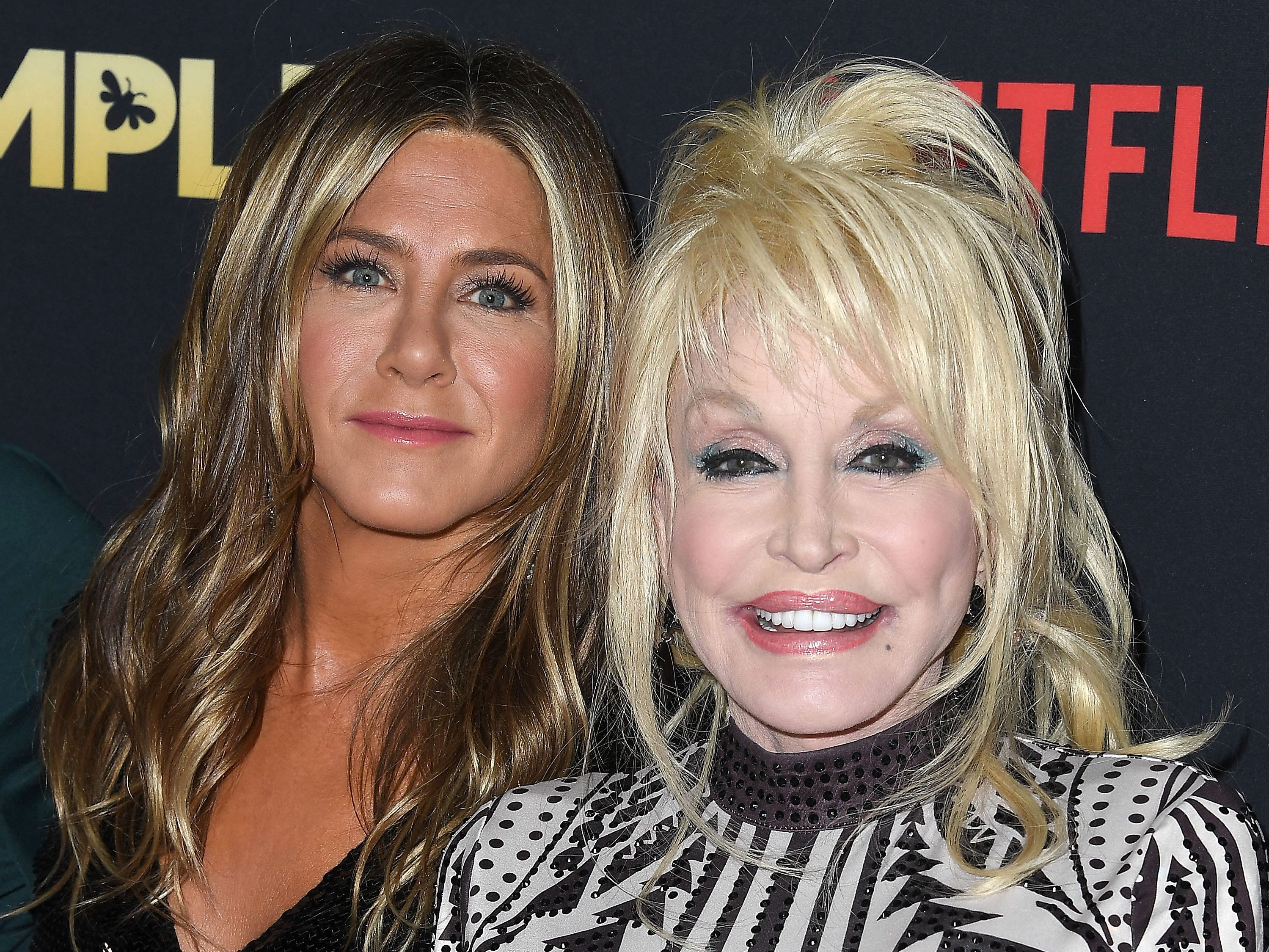 """While doing press for """"Dumplin',"""" Parton, whose music can be heard throughout the film, told Jimmy Fallon that her husband fantasizes about a threesome with Aniston, though she discounted the odds of it ever happening. """"He can't even get it out to pee, much less for three."""" How did Aniston respond? She found it flattering and hilarious, telling USA TODAY """"No one in the world can get away with saying anything like that about their partner on live television, except Dolly. I mean, that is a quote."""""""