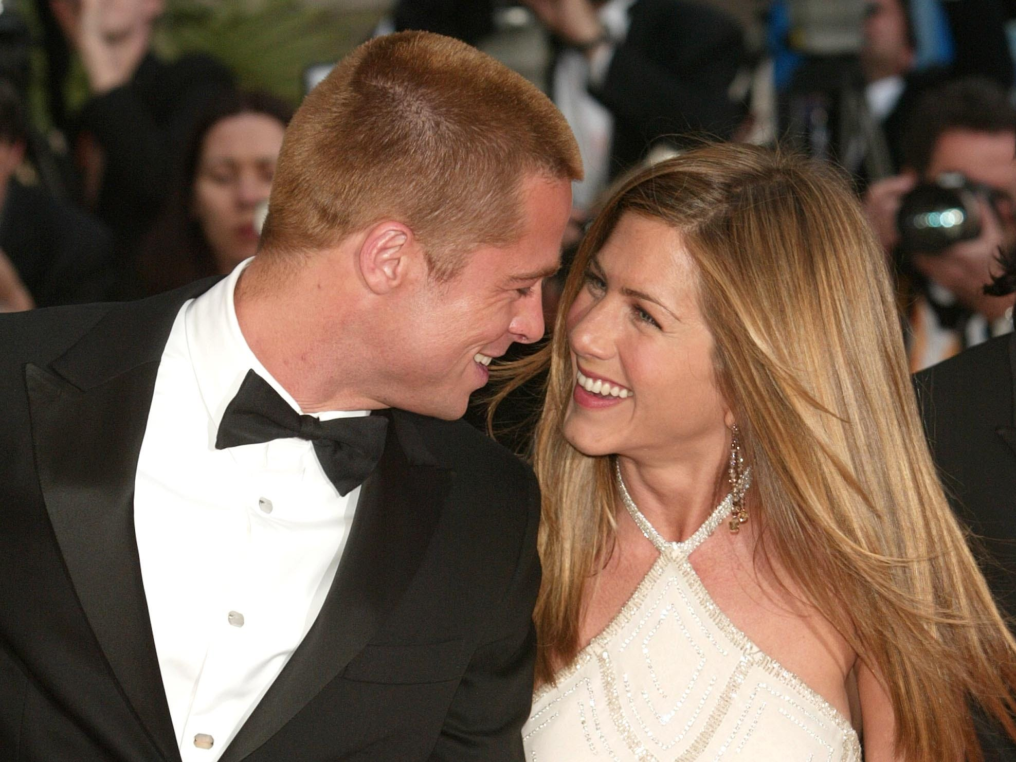 """Pitt and Aniston's relationship still looked to be on solid ground at the 2004 Cannes Film Festival premiere of his swords-and-sandals film """"Troy,"""" where they showed visible affection for each other."""