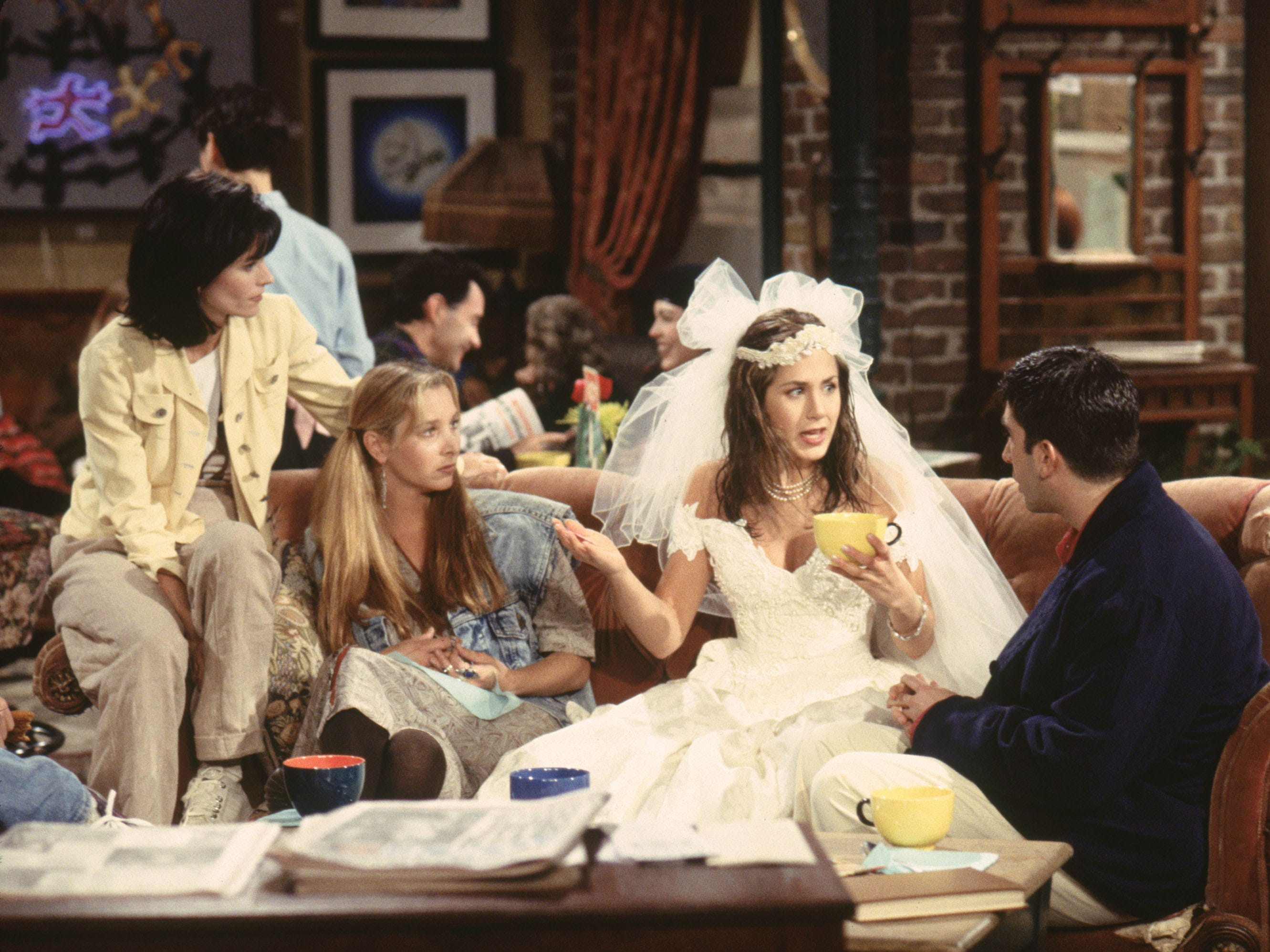 """For many Americans, their initial glimpse of Aniston was that of a wet runaway bride in the """"Friends""""  pilot. Her first scene found her character, Rachel Green, reuniting with high school friend Monica Geller (Courteney Cox, left) in Central Perk after ditching her fiance at the altar."""