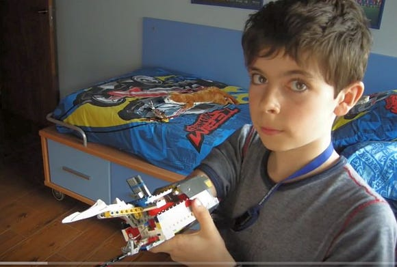 A young David Aguilar shows off an early version of his Lego arm.