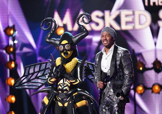 "The Bee and Nick Cannon on ""The Masked Singer."""