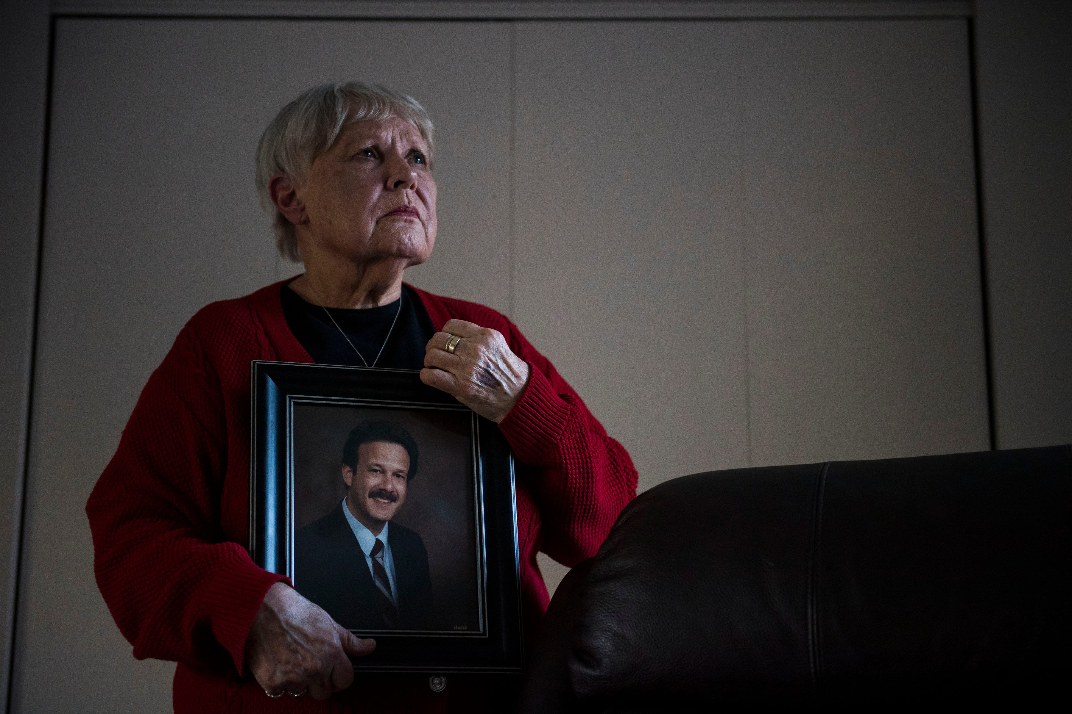 Chris Winokur poses for a portrait with a photo of her late husband, former Fort Collins City Councilman and Mayor, Robert Winokur, on Thursday, Jan. 31, 2019, in Estes Park, Colo.