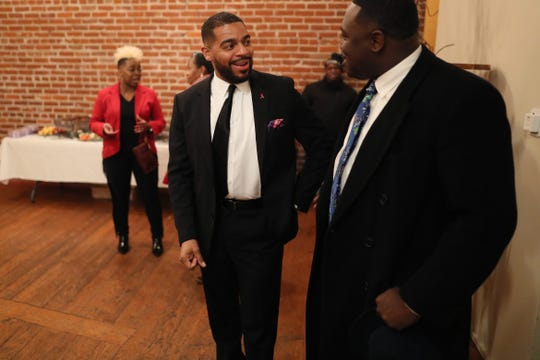 Memphis police officer and LGBTQ liaison for the department, Davin Clemons, who sued for discrimination against the MPD in 2014, chats with attendees during his Memphis City Council run kickoff party in downtown Memphis, Tenn. on Jan. 31, 2019.