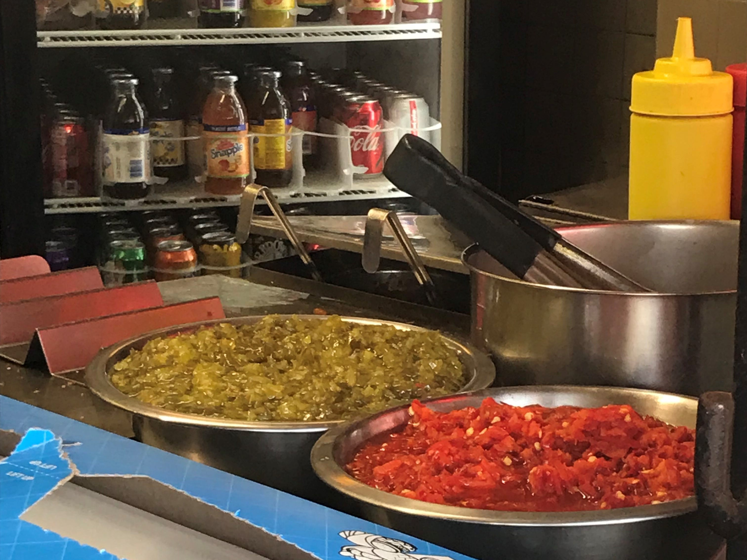 The standard Italian hot dog has fried potatoes, onions, peppers and ketchup, but you can dress it up with additional condiments as you see fit.