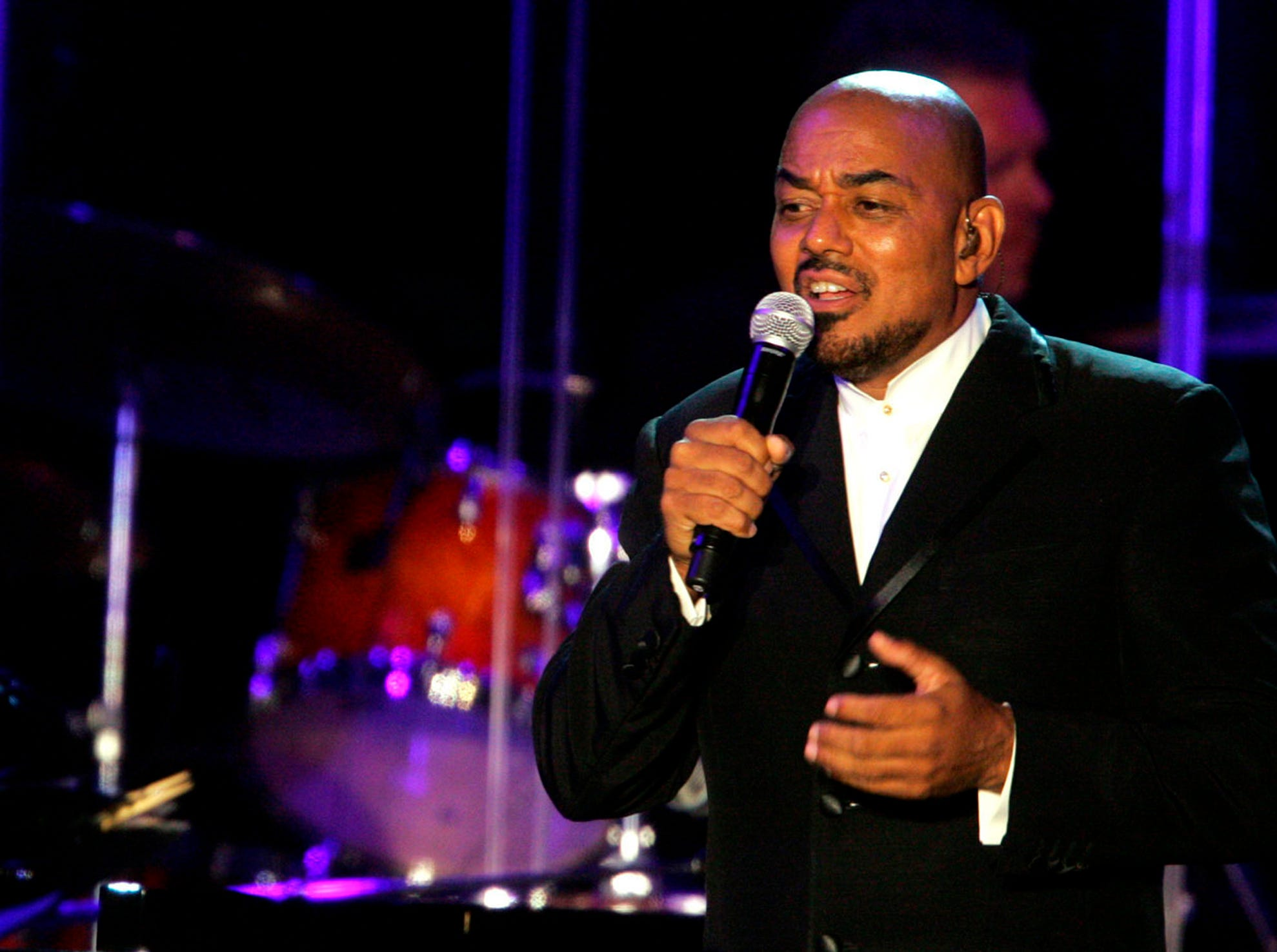 "In this July 28, 2007, file photo, James Ingram performs during the Grammy Foundation's ""Starry Night Benefit Honoring Quincy Jones"" held at UCLA Tennis Center in Los Angeles. Ingram, the Grammy-winning singer who launched multiple hits on the R&B and pop charts and earned two Oscar nominations for his songwriting, has died. He was 66. Debbie Allen, and actress and Ingram's frequent collaborator, announced his death on Twitter on Tuesday, Jan. 29, 2019."