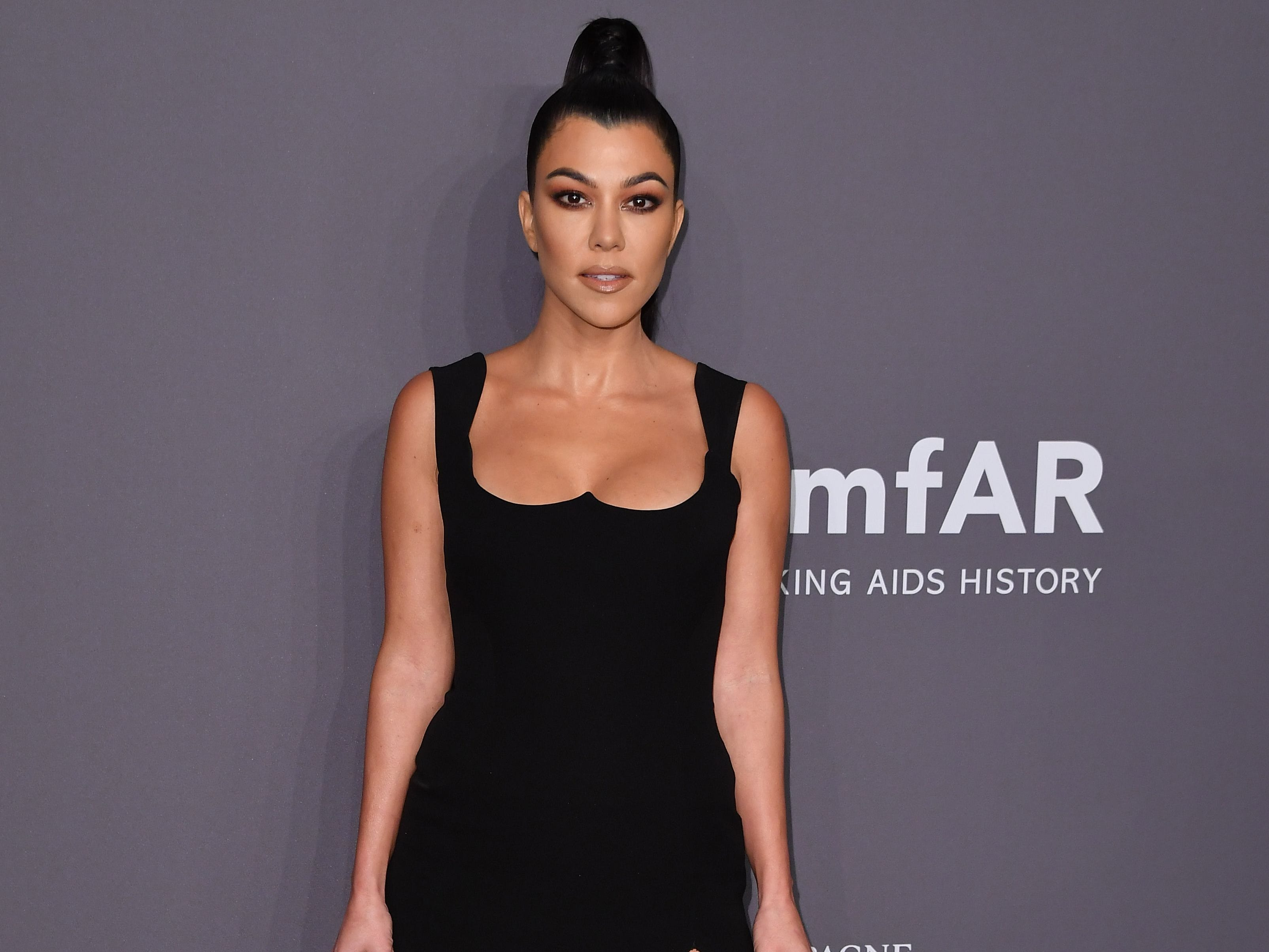 US media personality Kourtney Kardashian arrives to attend the amfAR Gala New York at Cipriani Wall Street in New York City on February 6, 2019. (Photo by ANGELA WEISS / AFP)ANGELA WEISS/AFP/Getty Images ORIG FILE ID: AFP_1D46SC