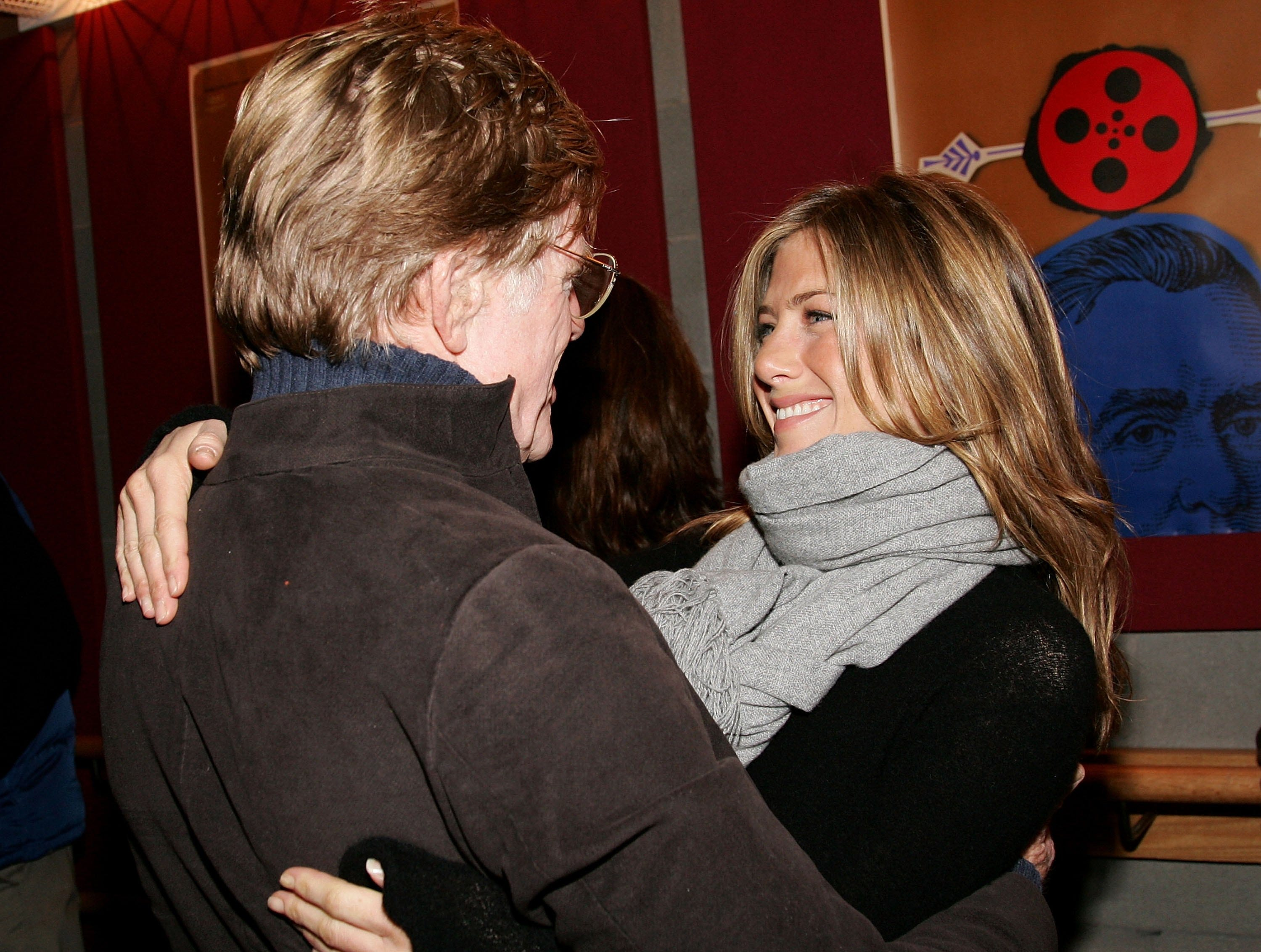 """In January 2006, Aniston bundled up to promote """"Friends With Money"""" at the Sundance Film Festival in Park City, Utah, where she got a hug from founder and Sundance Institute President Robert Redford."""
