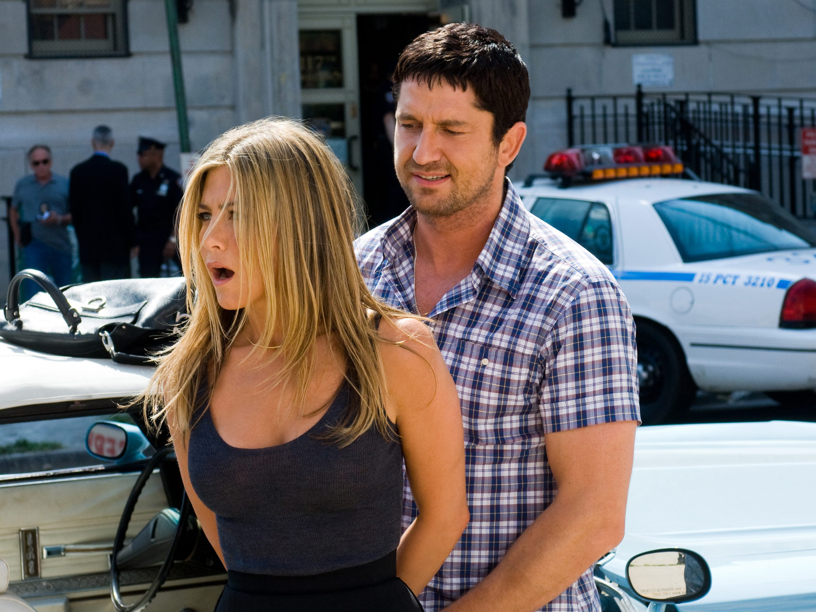"""In 2009's """"The Bounty Hunter,"""" Aniston played the bail-skipping wife of a bail-enforcement agent (Gerard Butler), who is hired to bring her in."""
