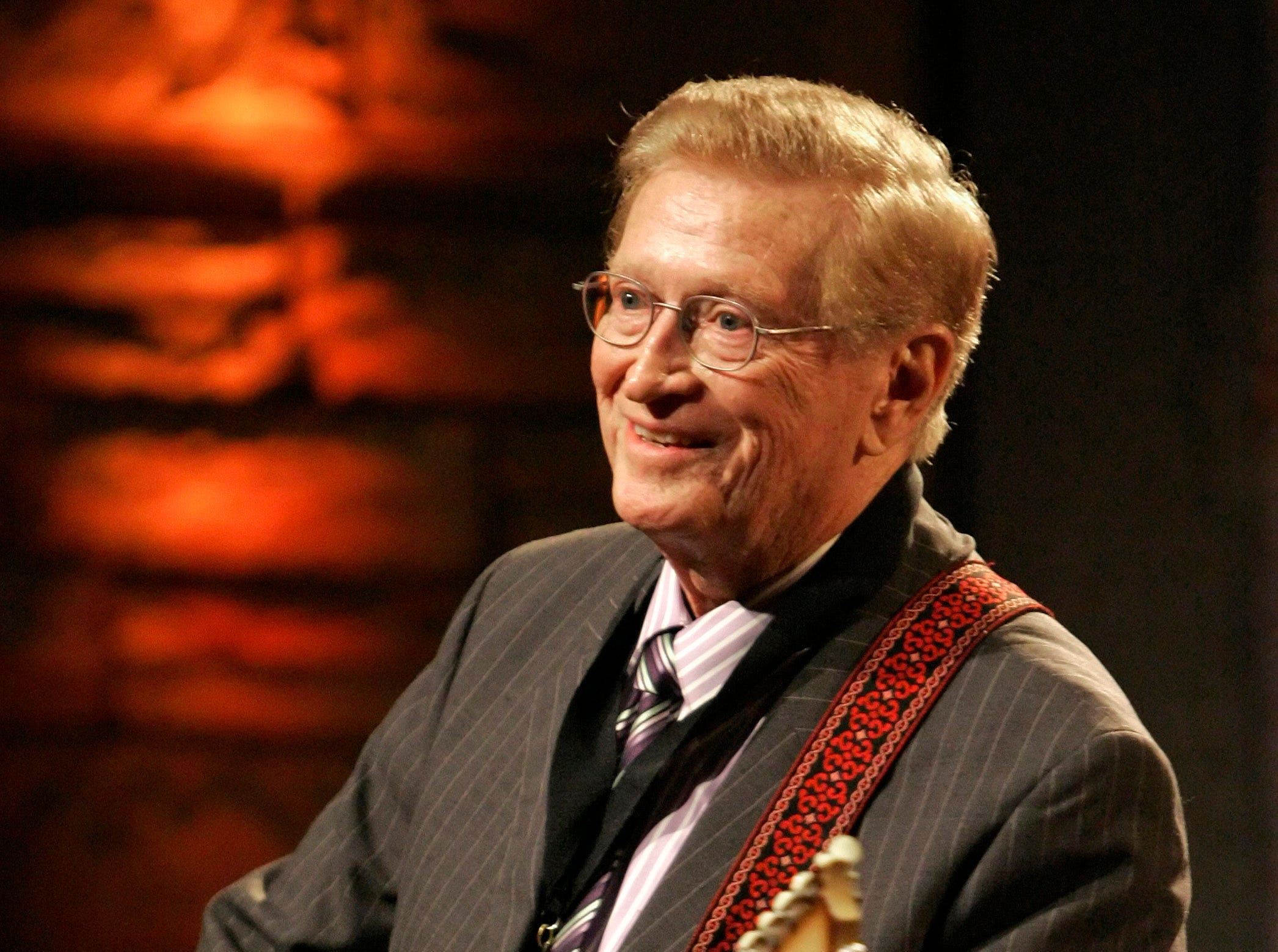 "In this May 6, 2007 file photo, Guitar player Harold Bradley performs at the Country Music Hall of Fame Medallion Ceremony in Nashville, Tenn.  Bradley, who played on hundreds of hit country records and along with his brother, famed producer Owen Bradley, helped craft ""The Nashville Sound,"" has died. He was 93. His daughter Beverly Bradley said he died Thursday, Jan. 31, 2019 ."