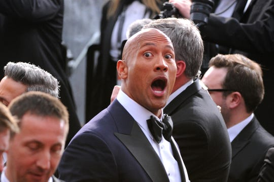 Dwayne Johnson, arriving at the 2015 Oscars, could have brought some swagger as Oscars host. He was too busy on 'Jumanji 2.