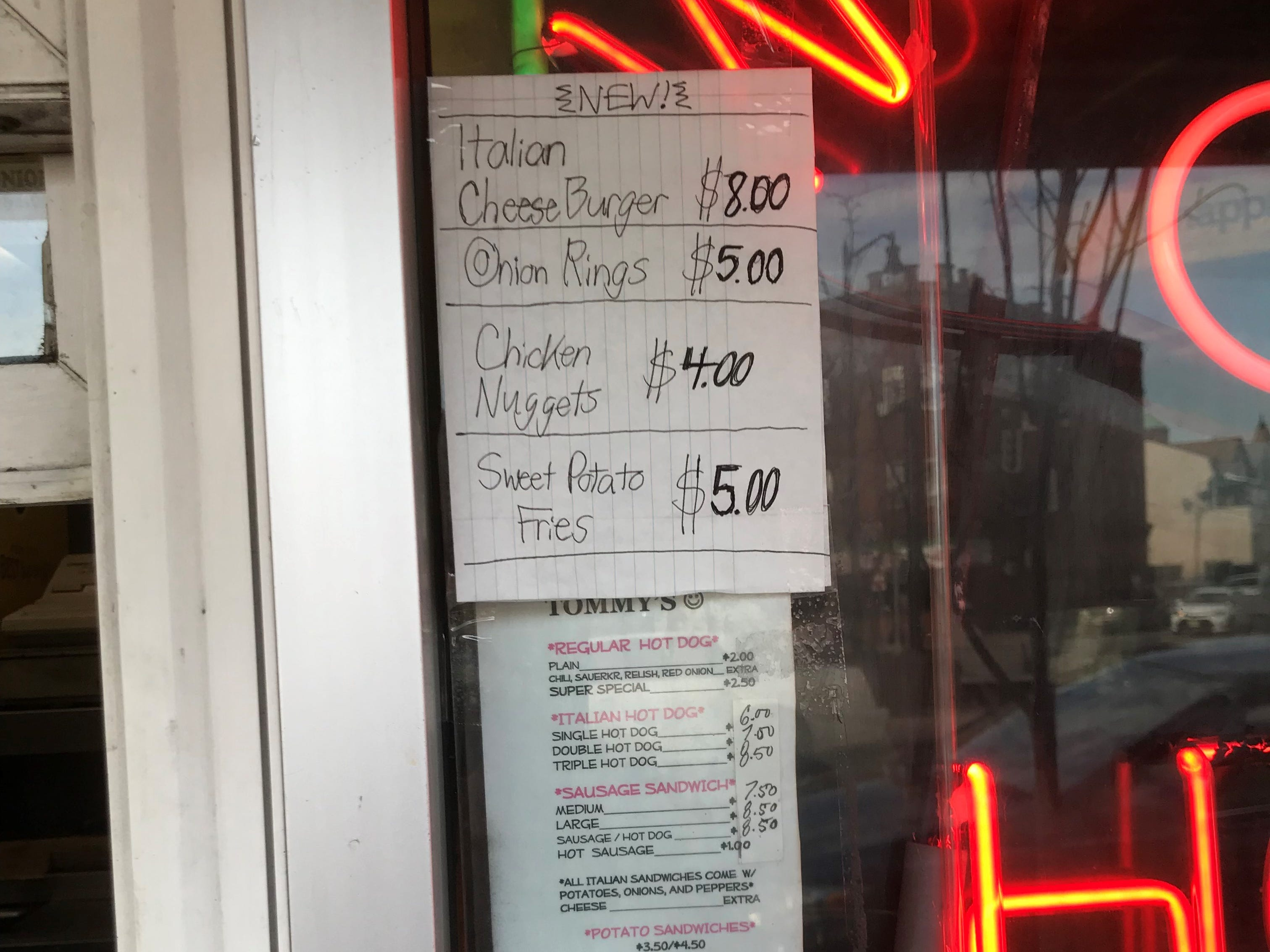After 50 years in business, Tommy's has expanded the menu slightly, but didn't bother to reprint it.