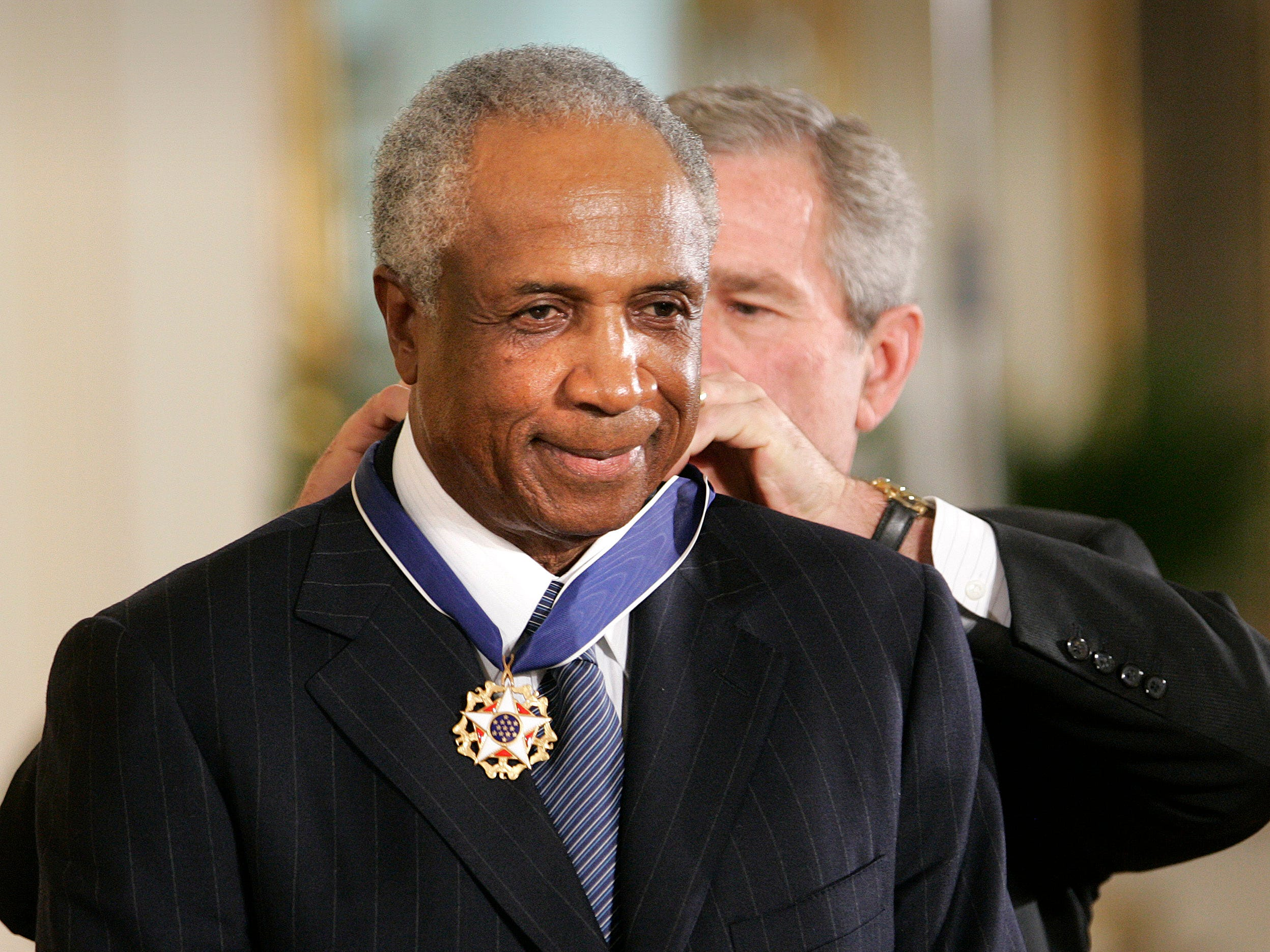 President Bush awards Frank Robinson the Presidential Medal of Freedom Award in the East Room of the White House in 2005, in Washington. The Presidential Medal of Freedom is the highest civilian award given.(AP Photo/Lawrence Jackson) ORG XMIT: DCLJ103