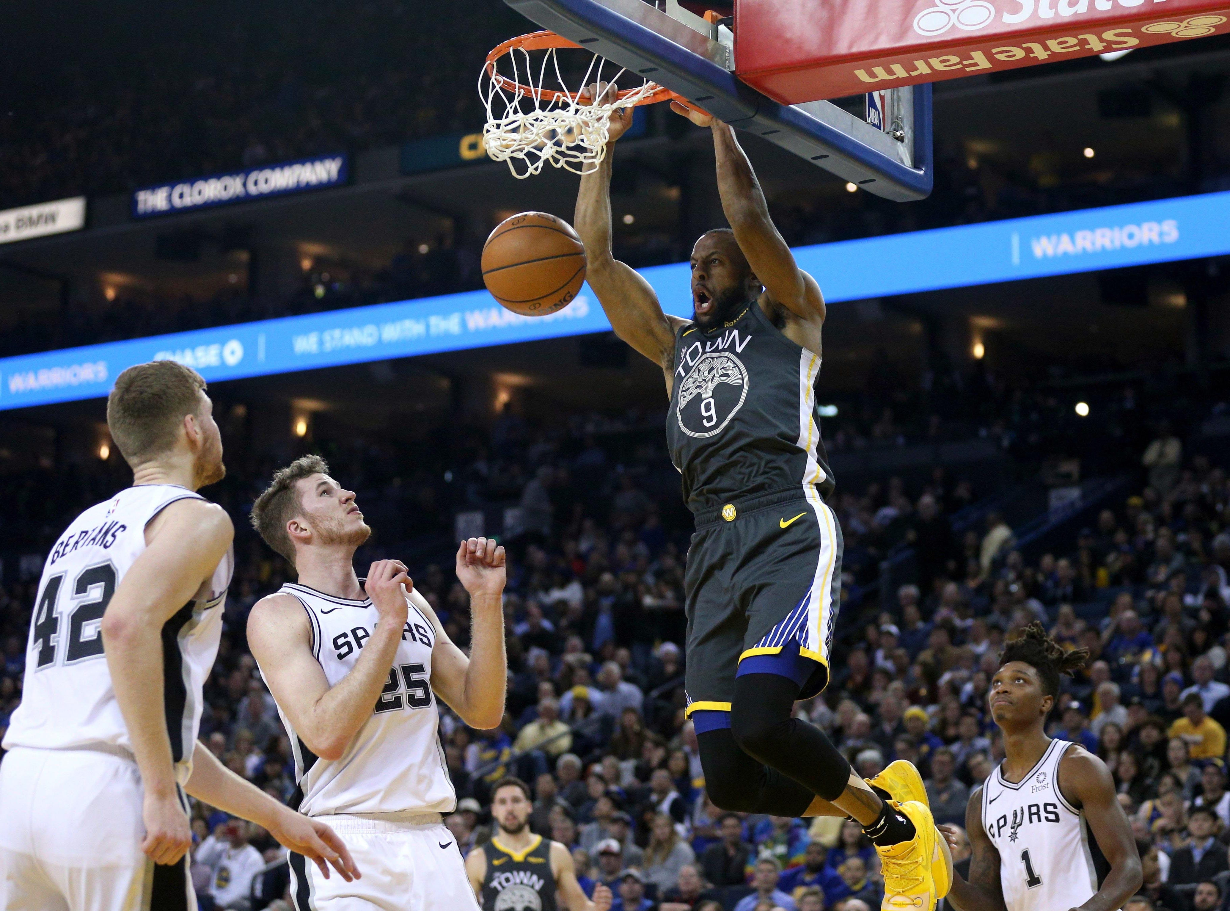 Feb. 6: Golden State Warriors guard Andre Iguodala dunks the ball against the San Antonio Spurs in the second quarter.