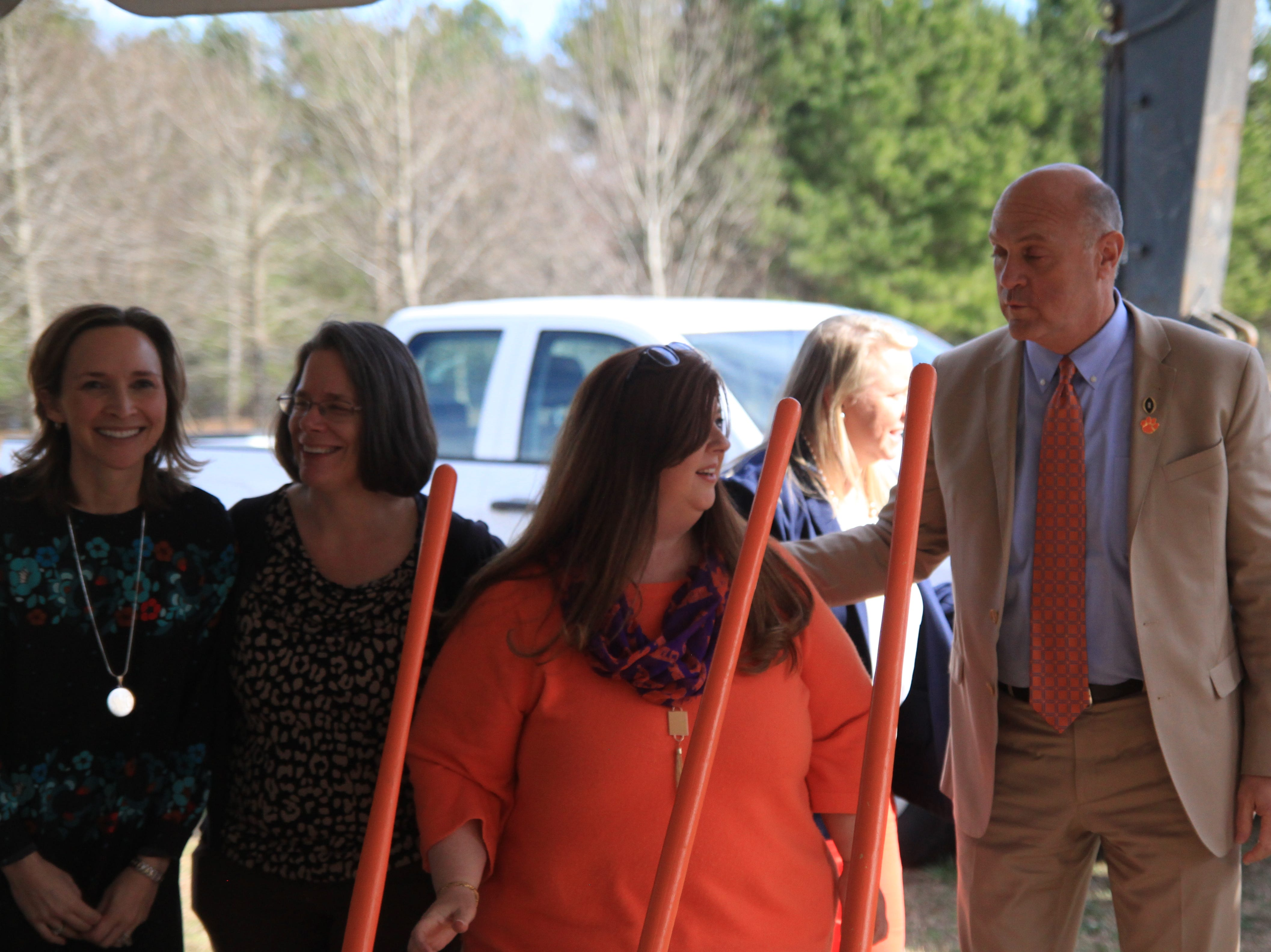 Past and current members of the President's Commission on Women join the groundbreaking for the Child Development Center.
