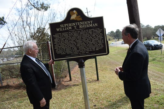 Retired Gen. Jasper Welch (left) and F. King Alexander, president of Louisiana State University, unveil a historical marker celebrating the contributions of LSU's first president, William Tecumseh Sherman. The marker is located on Highway 71 across from the Alexandria Veterans Affairs Medical Center in Pineville next to the headquarters of the Kisatchie National Forest on the site where the original LSU used to be. It was known as the Louisiana Seminary of Learning in Pineville and was destroyed by fire. Ruins of the old buildings still remain. The ceremony was hosted by the Historical Association of Central Louisiana.
