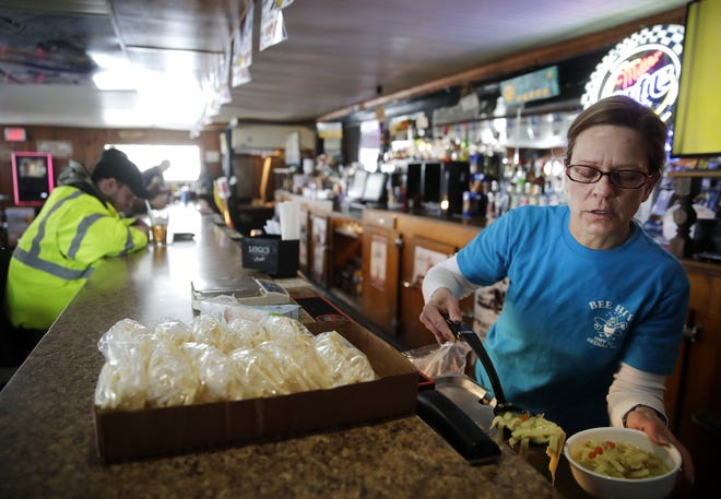Dena Olson, with the Bee Hive Inn, fills a bowl of soup during lunch for a customer. The Vinland bar and grill will be in the way of roundabout construction in 2020, and is slated to relocate.
