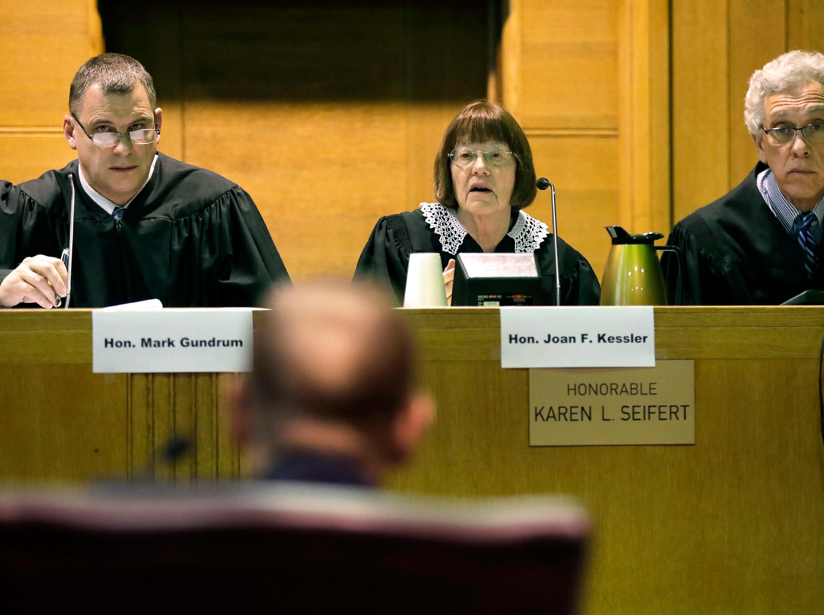 Fox Crossing Municipal Judge Len Kachinsky faces a panel of judges; Hon. Mark Gundrum, Hon. Joan F. Kessler and Hon. William Brash III, during a Judicial Commission disciplinary hearing on Thursday, February 7, 2019, at the Winnebago County Courthouse in Oshkosh, Wis.
