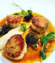 Pan-seared dayboat scallops with escargot, parsnip puree and lobster bordetto at Rumson House.