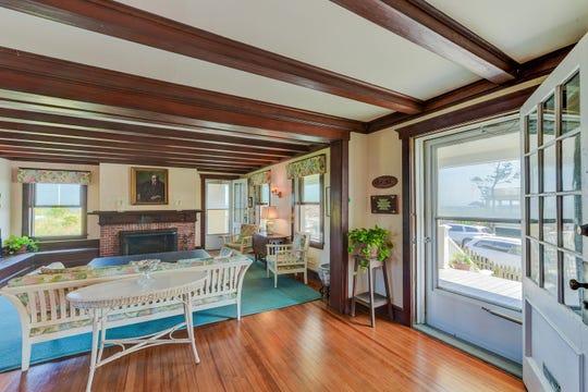 The Living Room features hardwood floors and fir wood beamed ceilings.