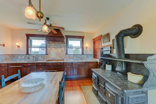 The eat-in kitchen features a butler's pantry and granite-stone counters.