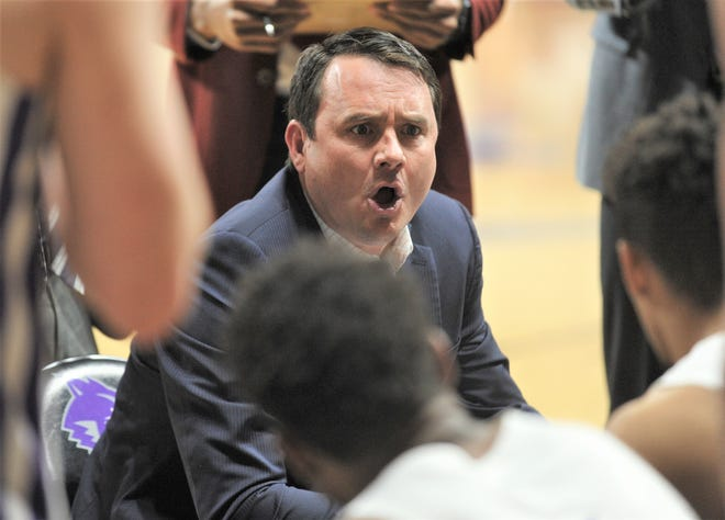 ACU coach Joe Golding talks to his team during a time out late in the Wildcats game against Northwestern State. ACU won the game 78-69 on Jan. 19, 2019, at Moody Coliseum.