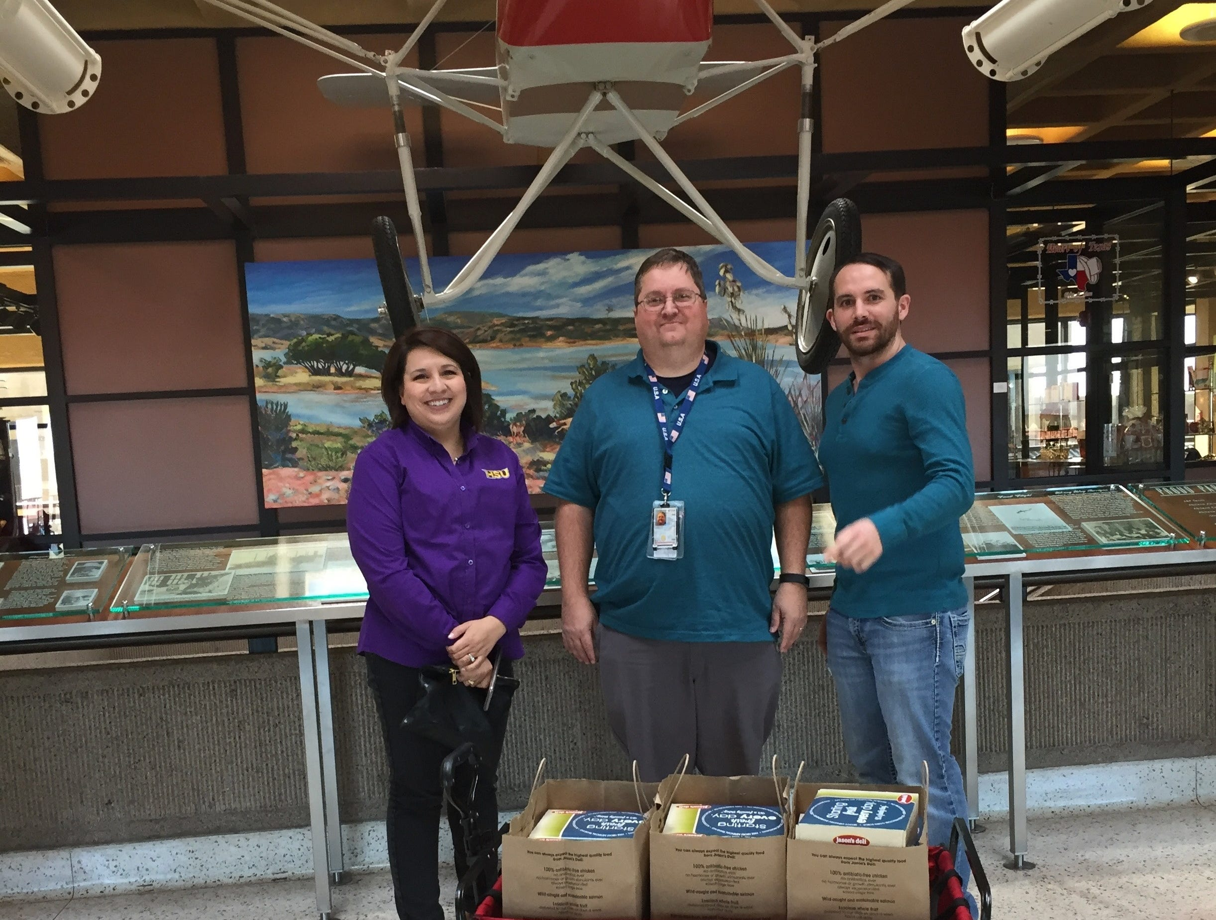 TSA manager Don Langford (center) receives lunches from Dr. Kristina Davis, Taylor County Democratic chairwoman, and Jake Lanehart for delivery to the TSA and air traffic controllers at Abilene Regional Airport during the government shutdown. The lunches were provided by the Taylor County Democratic Party and Big Country Democratic Women for unpaid essential Federal workers.