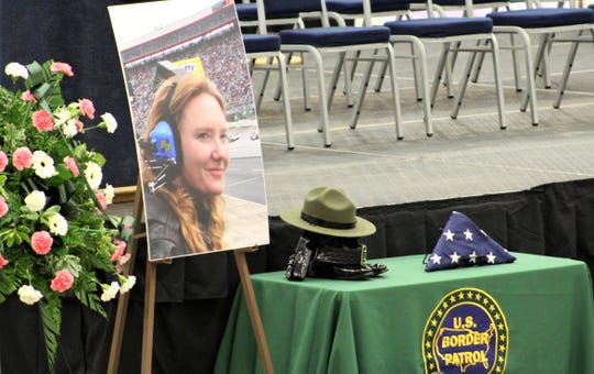 A photograph of Donna Doss at a NASCAR race was displayed next to a hat, footwear and belt at Friday's memorial service at the Taylor County Coliseum.