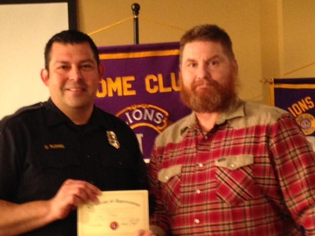 Fire Chief Cande Flores meets with Cactus Lions Club president Fred Vaught after presenting a program to the club.